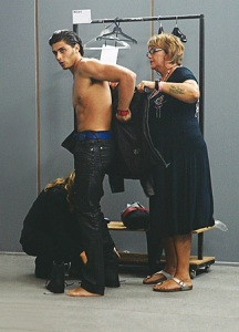Jesus Luz getting dressed backstage of Ellus fashion show