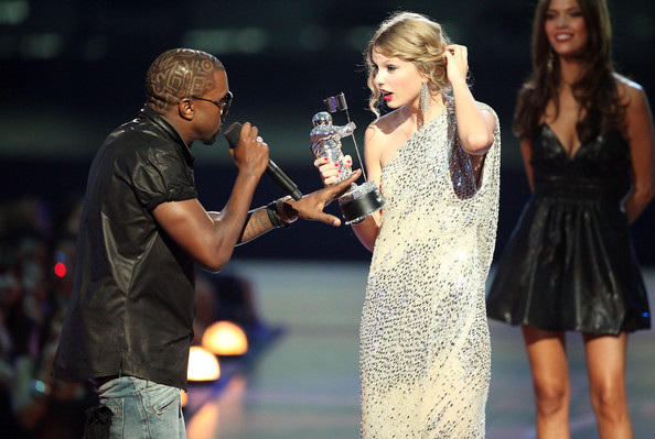 Kayne West jumps onstage after Taylor Swift won the Best Female Video award and takes over the microphone